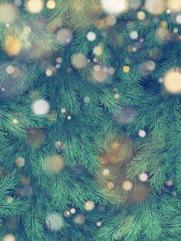 Árvore de natal verde ramos de pinho e ouro guirlanda de luzes.