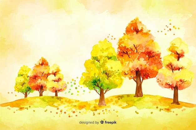 Árvore de outono em aquarela e folhas de fundo