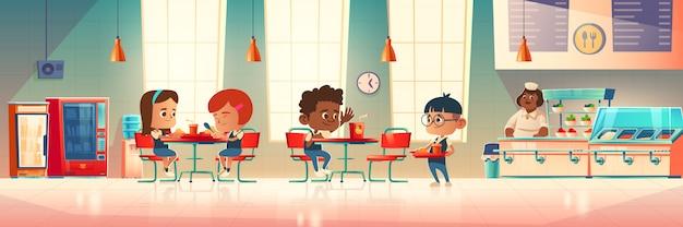 As crianças comem na cantina da escola