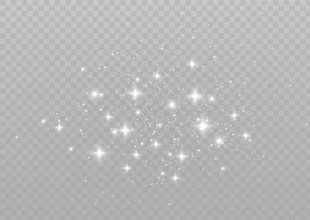 As faíscas de poeira e estrelas douradas brilham com luz especial partículas de poeira mágicas cintilantes