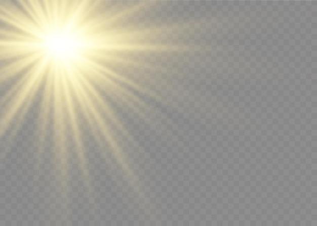 As faíscas de poeira e estrelas douradas brilham com uma luz especial. brilha em um fundo transparente. efeito de luz de natal. partículas de poeira mágica cintilantes no interior