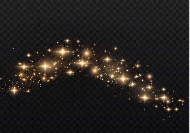 As faíscas de poeira e estrelas douradas brilham com uma luz especial. brilha em um fundo transparente. efeito de luz de natal.