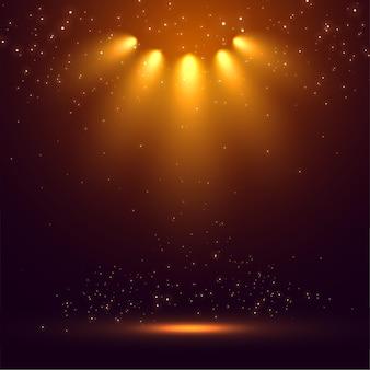 As luzes do palco iluminam o fundo brilhante