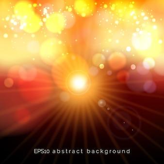 As luzes pastel festivas do bokeh vermelho e amarelo brilham no fundo com uma estrela brilhante. sol estrela de brilho abstrato desfocado