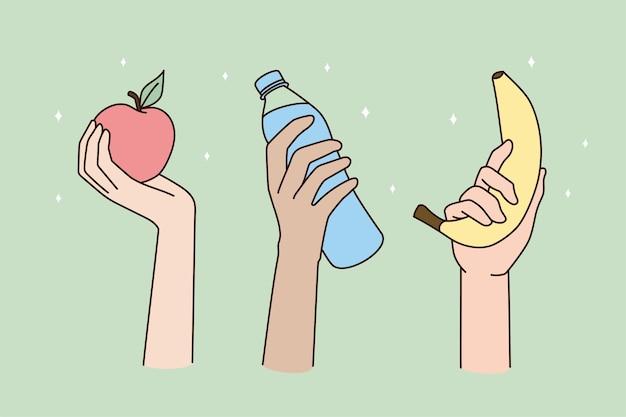 As mãos das pessoas seguram bons produtos para um estilo de vida saudável
