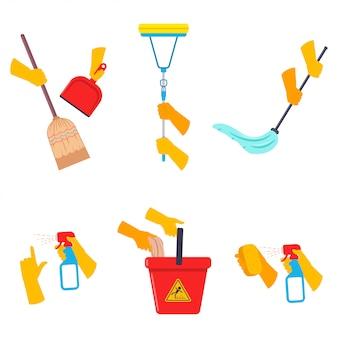 As mãos humanas mantêm o grupo dos desenhos animados das ferramentas de limpeza isolado em um fundo branco.