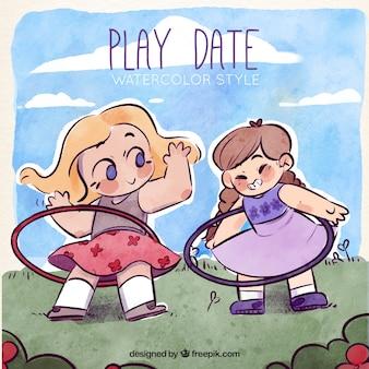 As meninas de sorriso que jogam com aros de plástico