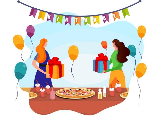 As mulheres adoráveis trocam com os presentes perto da tabela festiva.