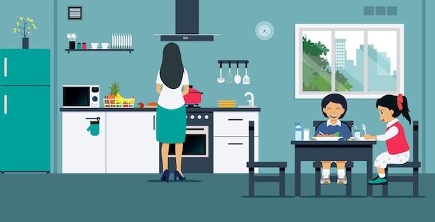 As mulheres estão preparando o café da manhã para as crianças na cozinha.