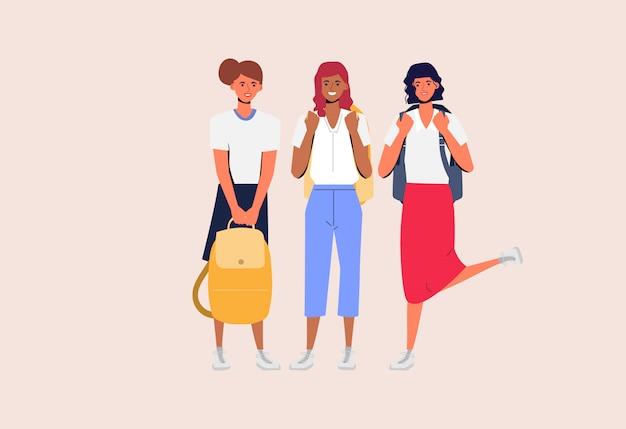 As mulheres jovens são estudantes universitários acadêmicos com amizade.