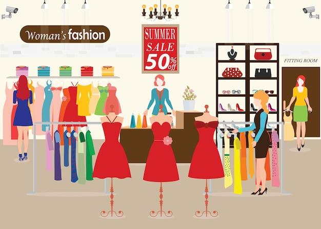 As mulheres que compram em uma loja de roupas com manequins mostram.
