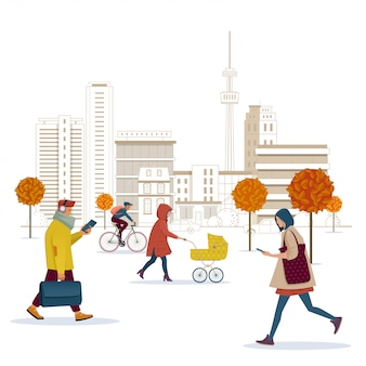 As pessoas andam ao longo da rua da cidade de outono