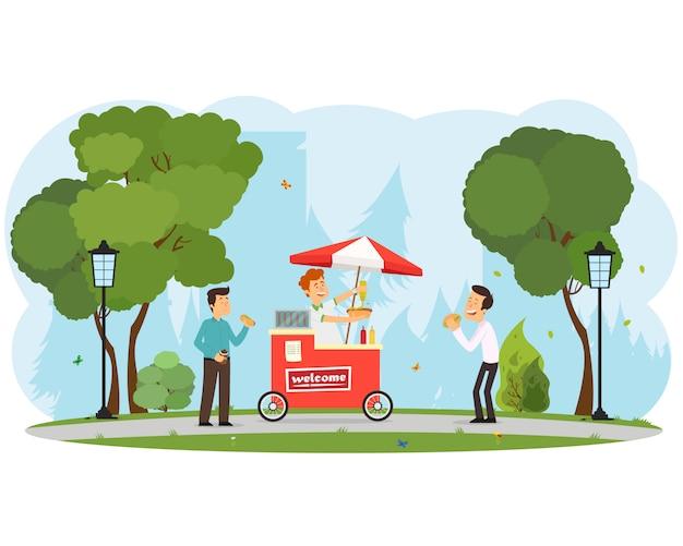 As pessoas compram e comem cachorros-quentes no parque da cidade.