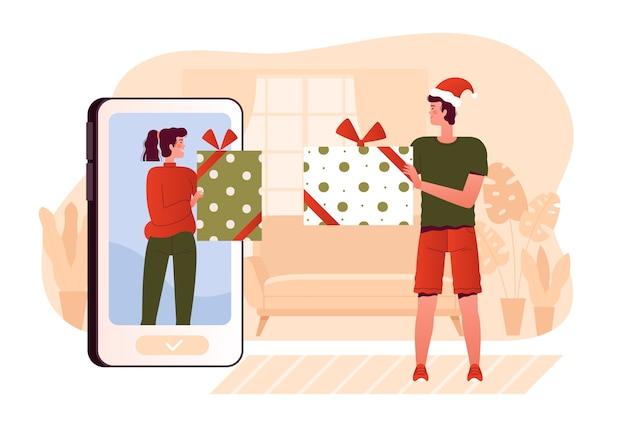 As pessoas dão presentes umas às outras pela internet. saudações de feliz natal por telefone. férias sem contato e proteção covid-19. apartamento de desenho animado. Vetor Premium