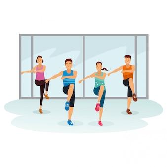 As pessoas estão se exercitando juntas na sala de ginástica