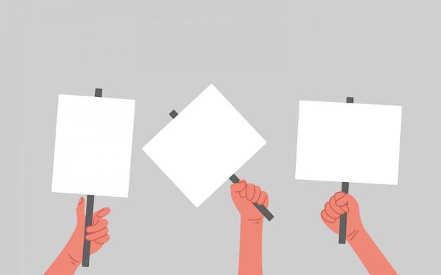 As pessoas mão segurando sinais, banners e cartazes em uma manifestação de protesto ou piquete