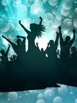 As pessoas silhueta dançando na festa