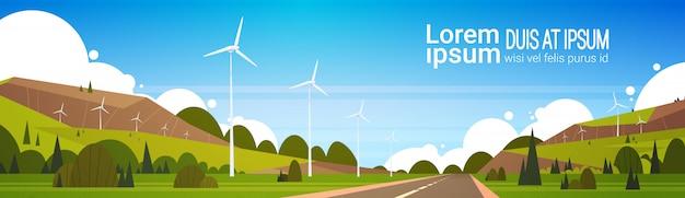 As turbinas eólicas aproximam o conceito alternativo do poder do espaço natural da cópia do woth do fundo da paisagem da estrada