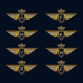 Asas com alfabeto e escudo logotipo coleções