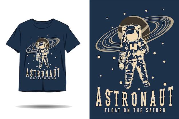 Astronauta flutua no design da camiseta da silhueta de saturno