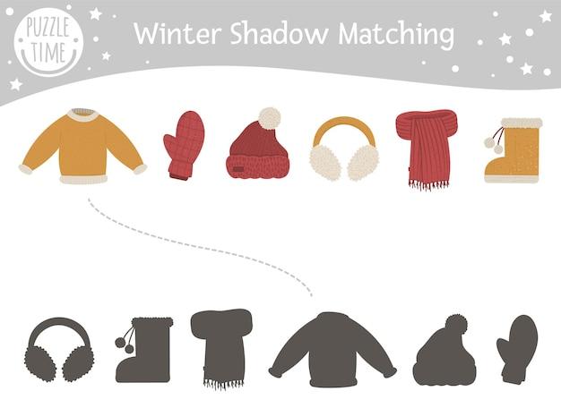 Atividade de combinação de sombras de inverno para crianças com roupas quentes.
