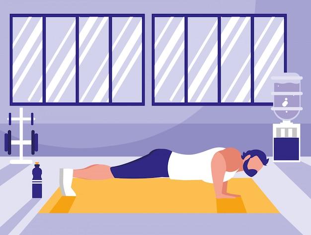 Atlético jovem fazendo flexões no peito no ginásio