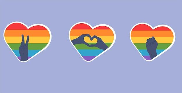 Autocolantes em forma de coração com a bandeira lgbt com as mãos que significam vitória, paz, amor e luta pelos direitos.