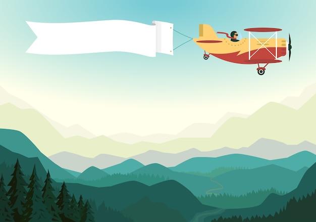 Avião acima das montanhas com fita branca no céu azul.