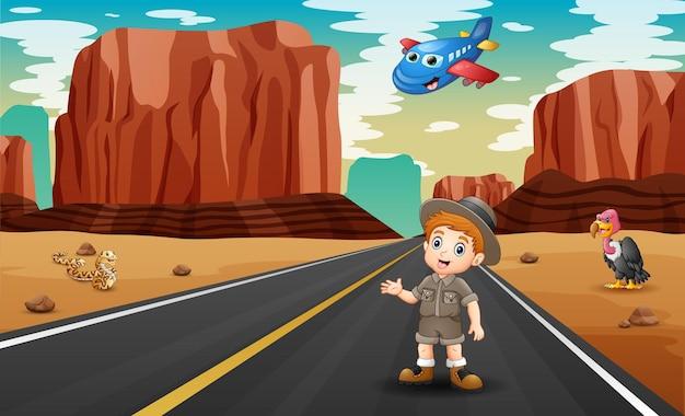 Avião de desenho animado e um menino na ilustração de uma estrada no deserto