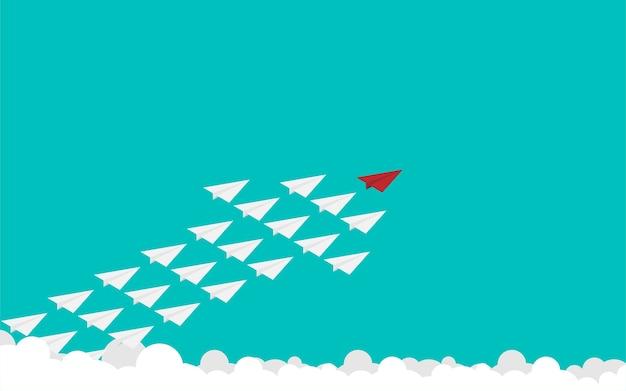 Avião de papel vermelho e muitos brancos no céu