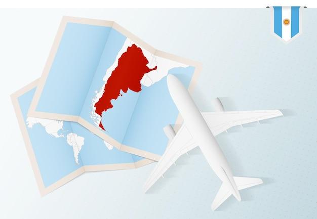 Avião de vista superior com mapa e bandeira da argentina.