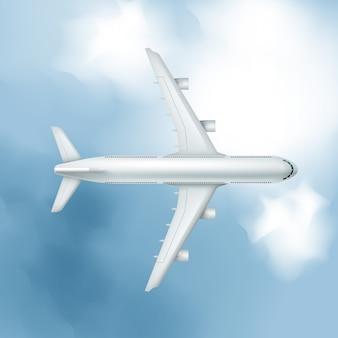 Avião realista sobre fundo de céu nublado, vista de cima.