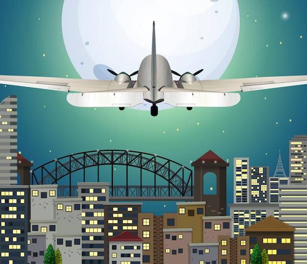Avião sobrevoando a cidade urbana