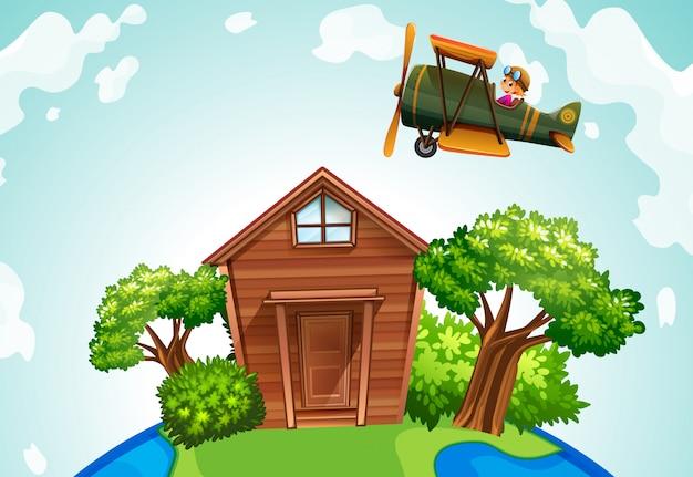 Avião sobrevoando uma casa de madeira