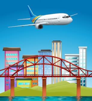 Avião voando sobre edifícios