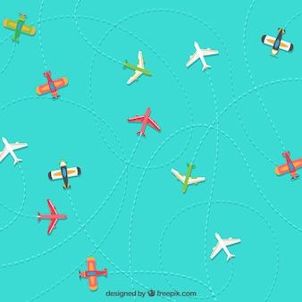 Aviões coloridos viajando de fundo