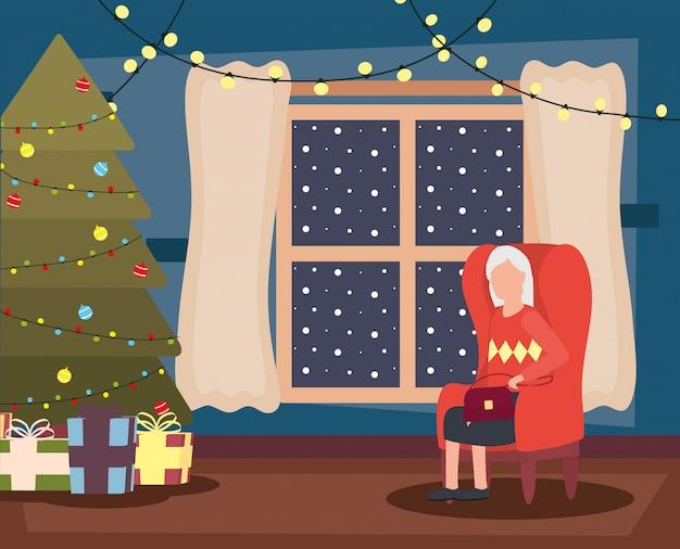 Avó na sala de estar com decoração de natal