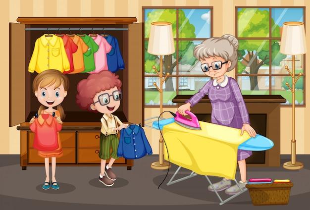 Avó passar roupa para crianças