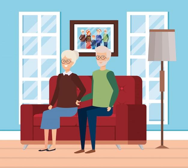 Avós na sala de estar com roupas de inverno