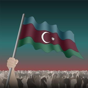 Azerbaijão acenando uma bandeira na mão entre a multidão.