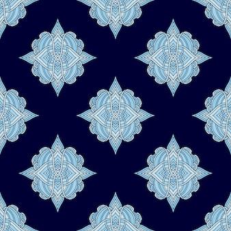 Azulejo padrão sem emenda com flores de arabesco. fundo real nas cores azuis.