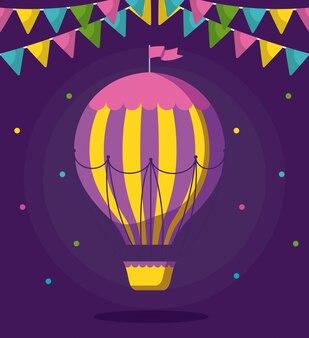 Balão ar quente voando com guirlandas