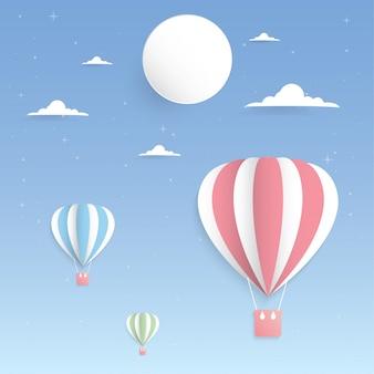 Balão colorido na arte de papel céu e lua