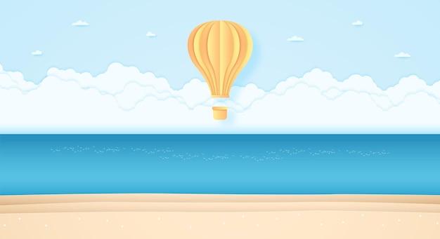 Balão de ar quente brilhante voando sobre o mar no céu azul e na praia, estilo arte em papel