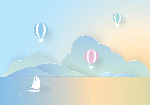 Balão de ar quente colorido flutuando sobre o mar, corte de papel
