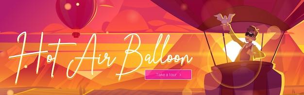 Balão de ar quente com homem e pomba ao pôr do sol