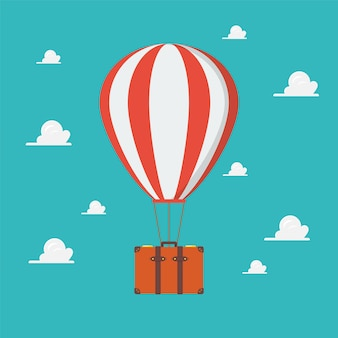 Balão de ar quente com mala de viagem