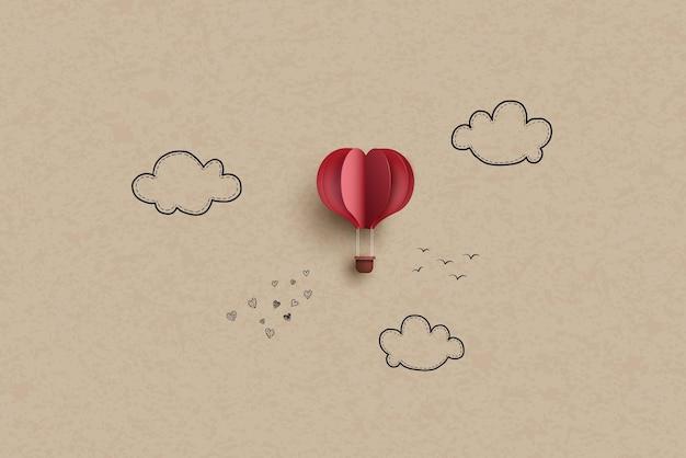Balão de ar quente em forma de coração no céu. desenho à mão e estilo recortado