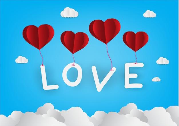 Balão de ar quente em um coração. estilo de arte em papel. dia dos namorados, texto de amor