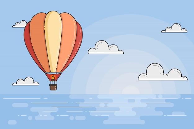 Balão de ar quente no céu azul com nuvens sob o mar